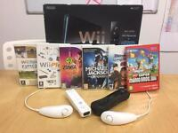 Black Nintendo Wii with 6 Games