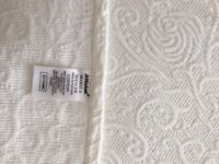 Kingsize bed throw in White heavy cotton with scalloped edge.