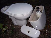 White toilet with seat
