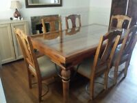 Wooden dining table with glass top and 4 matching chairs
