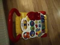 Baby walker plays music.