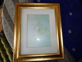Print of angels in distressed wood frame