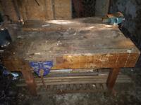 School style heavy workbench inc 3 vices.
