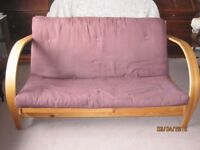 Brown Futon with light wooden frame