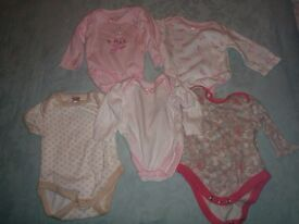 5 Baby body suits