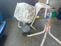 Cement mixer belle comes with a stand works but start button won't stay in can deliver local