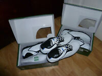 Three pairs of golf shoes