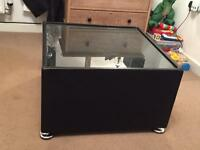 Black glass topped coffee table