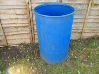 blue plastic water etc storage barrels for allotment etc
