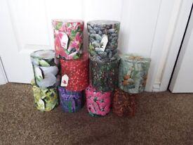 10 individualy designed circular gift boxes