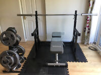 Home gym including squat rack, benches, 150kg weights + weight tree, bars, dumbbells and more...