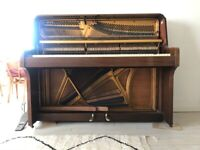 Upright Schwander piano