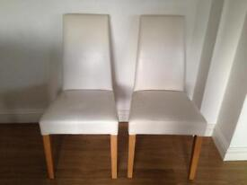 Eight faux leather ivory dining chairs