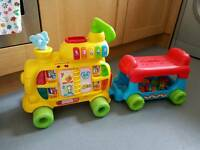 Vtech alphabet train and ride on