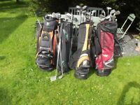 Job lot of 60 golf clubs and irons, 3 golf trolleys and bags