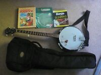 Rally 5 string banjo with gig bag and tuition books