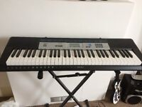 Casio Keyboard with stand and headphones