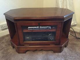 Dark oak TV stand/cabinet on wheels with leaded windows