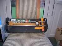 Tile cutter and tile saw in good condition.{FOSTON}