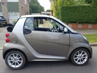 convertable smart car with touch screen entertainment system also tiptronic gearbox low mileage