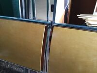 Metal double bed with wood insert on headboard - no mattress