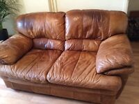 2 brown untreated leather 2-seater settees for sale