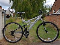 Full suspension 18 gear mountain bike. 26in wheel, 18.5in frame. Suit 5ft9+.