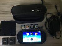 PS Vita Slim + Case + 64gb memory card + 8gb memory card + 22 games + charger