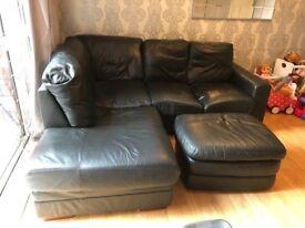Black leather corner sofa &footstool