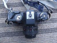Praktica BX 20 With 200 ml Lens, Flash Gun, Films, Batteries, Bag and Strap.