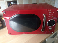 RED DAEWOO MICROWAVE OVEN IN EXCELLENT CONDITION