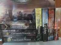 The Mortal Instruments books with poster, and The Infernal Devices books