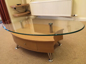 Lovely glass topped oval coffee table with a drawer and light beech wood base.