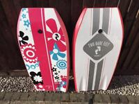 Two bare feet body boards new