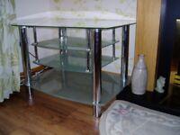 Glass and chrome television/sky box unit