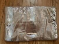 Used once River Island gold clutch bag