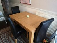 Extendable Oak dining table and 3 chairs