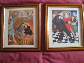 TWO PICTURES OF BERYL COOK'S WORK IN WOODEN FRAMES.