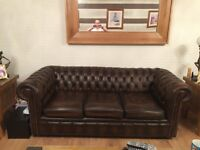 antique brown chesterfield settees,