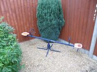Kids seesaw and roundabout