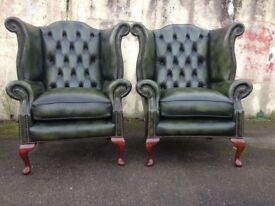 A pair of Green Leather Chesterfield Wingback Armchairs with Queen Anne legs.