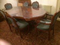 Dining table and six chairs in good condition.