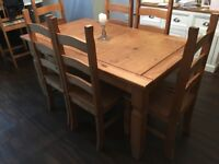 Corona pine dining table and 6 chairs for sale