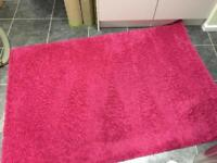 Cerise pink rug, good condition, smoke and pet free house