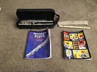 Notus flute with flute music book and a Yamaha Fife with music book