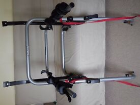 Halfords boot-mounted metal clamp carrier for three bicycles