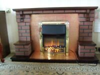 Dark wood and brick effect fire surround and dimplex electric fire