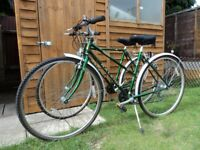 His and Hers - (Pair) Raleigh Pioneer 21 Trail or Town (hybrid) Bikes -18 Gear Shimano lightweight