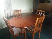 Dining room furniture for sale - dark wood table with 4 chairs, wall unit and book case