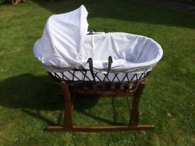 Dark wood Moses basket with rocking stand.